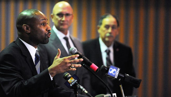 Department of Justice Office of Community Oriented Policing Services Policing Practices and Accountability Initiative Chief Noble Wray answers a question on Tuesday regarding the release of the Salinas Police Department initial report as part of the Collaborative Reform Initiative for Technical Assistance. To Wray's left are Salinas Police Chief Kelly McMillin and Mayor Joe Gunter.