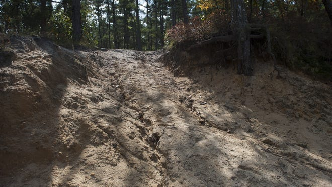 Off-road vehicles illegally created roads and caused other damage on Jemima Mount, the highest point in Wharton State Forest in the New Jersey Pinelands. New signage will be posted by the state in hopes of preventing further damage