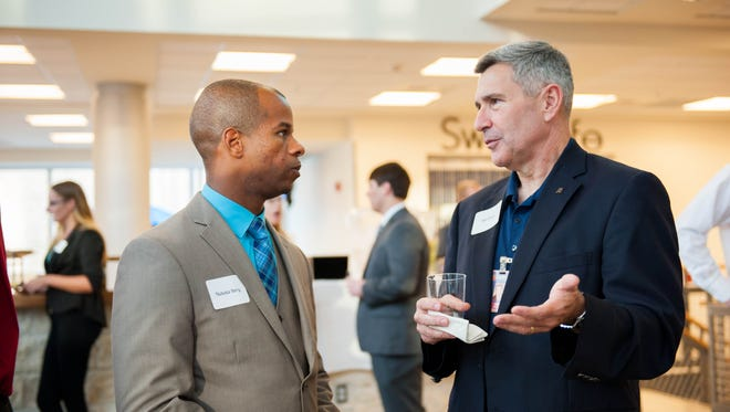 UWF student Nick Berry and Bill Cleary, vice president of client relations with Landrum, speak during a recent networking event. The UWF Executive Mentor Program matches local business leaders with business students to help them develop soft skills and choose their career path.