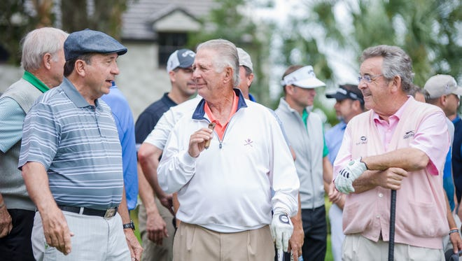 Johnny Bench, Larry Laoretti and Tony Jacklin share stories during the Nichols Cup Pro-Am Tournament.