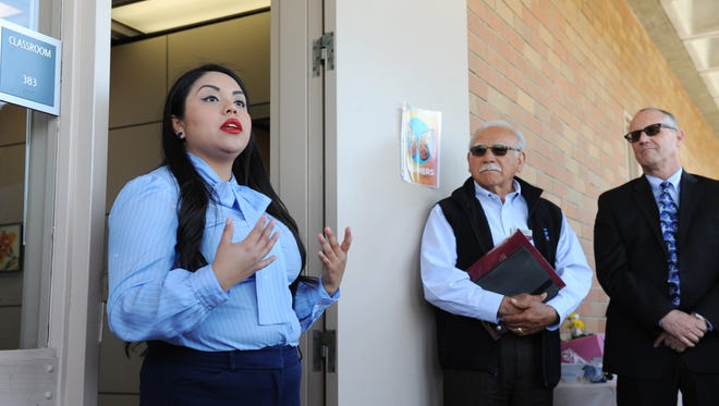 "At the opening of ""Mi CASA""  on Wednesday at Hartnell College, student Adriana Gonzalez talks about how important the new resource center for undocumented students will be. Hartnell board member Manuel Osorio, center, and president Willard Lewallen listen."