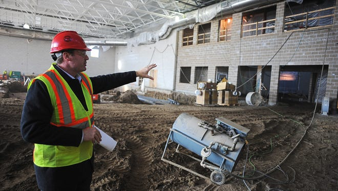 Tony Wiseman, project manager with Sioux Falls Construction, shows the recreation area at the construction site of the Midco Aquatic Center at Spellerberg Park.