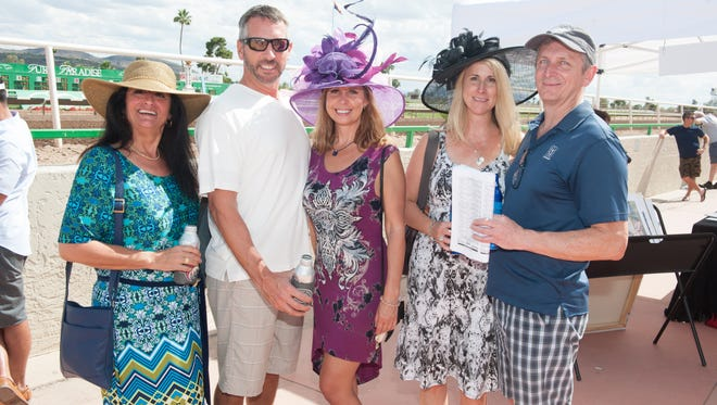Turf Paradise in Phoenix hosted their own Kentucky Derby Day on Saturday, May 7, 2016. The grandstand was full of spectators and bets were placed left and right while ladies donned their most extravagant hats, which they could even enter in the hat contest.