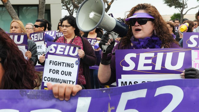 Monterey County social workers, eligibility workers and psychiatric social workers represented by SEIU Local 521 participate in a noontime protest on Tuesday on La Guardia Street in Salinas.