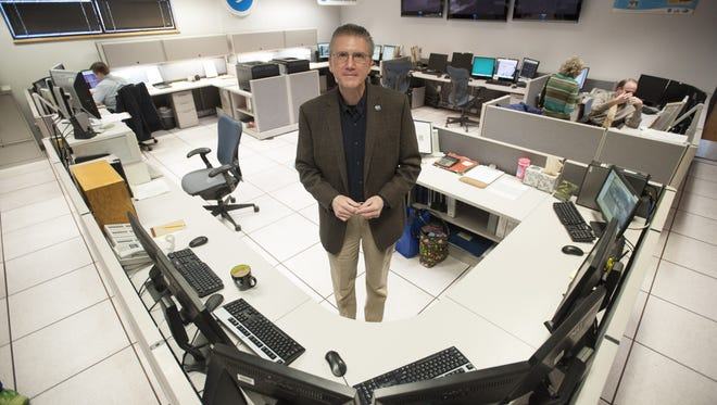 Cheif Meterologist Gary Szatkowski stands in th operations room at the National Weather Service in Mt. Holly.
