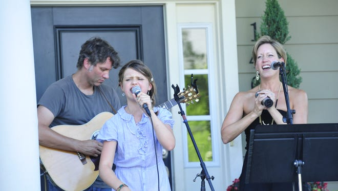 Performers during the 4th annual Porchfest in the Westhaven community.