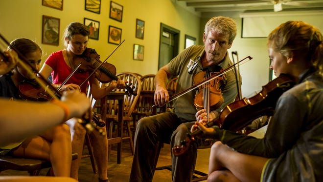Jonno Frsichburg, second from right, teaches a group of campers during the 2015 Louisiana Folk Roots' Kids Camp at Vermilionville.