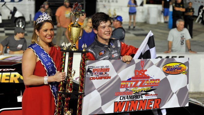 Harrison Burton celebrates his victory in the Rubber & Specialties 100 with Miss Five Flags Speedway Danielle Dunn on May 27, 2016.