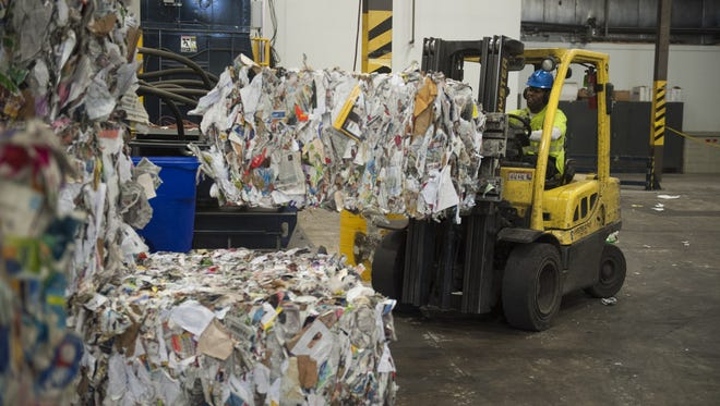 Bundles of sorted recycled material get stacked at the Robert C. Shinn Jr. Recycling Center in Westampton in 2015. New Jersey produces millions of tons of recycled material, but how can you reduce what goes to the curb?