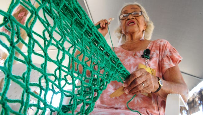 Antonia Tolentino Degracia Castro weaves a decorative talaya, or cast throw net, out of yarn during the Festival of Pacific Arts in this June 2, 2016, file photo.