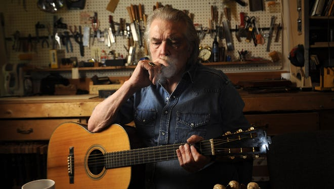 Guitar maker and songwriter Guy Clark at his workshop and home Tuesday, July 16, 2013 in Nashville.