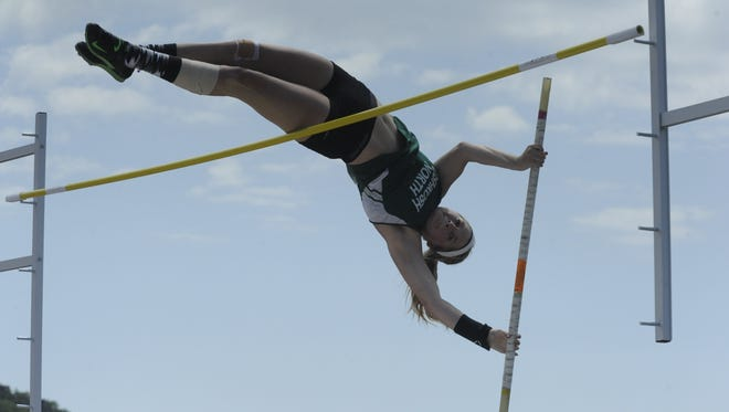 Oshkosh North's Erin Neveau goes over the bar on a pole vault attempt during the WIAA State Track and Field Meet on Friday.