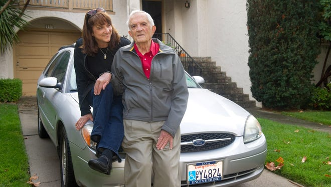 Charles Riley of Menlo Park and his daughter Frances Riley Bright with Charle's car, a silver Taurus, out front of Frances's home in Millbrae, Calif.