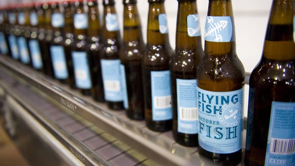 Flying Fish bottles come off an automated bottling machine at the Somerdale brewery shortly after the brewery moved from Cherry Hill in 2012.