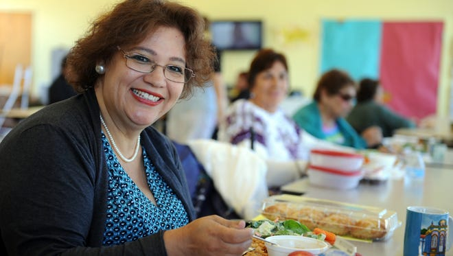 Rosalba Gonzalez has a healthy meal on Thursday at the Firehouse Recreation Center in Salinas.