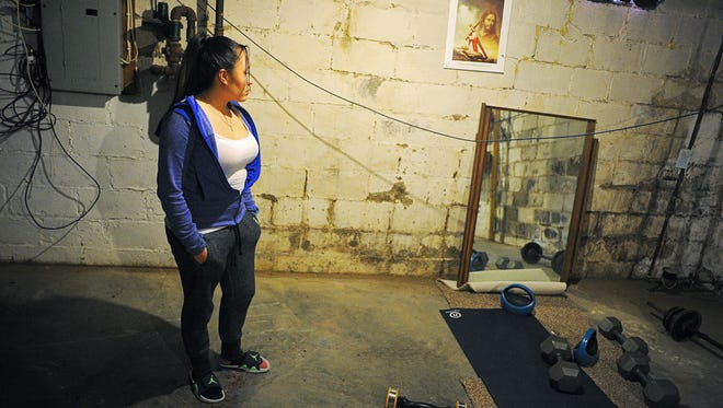 Tatiana Fuentes shows her basement Thursday, Feb. 25, 2016, in her home in Sioux Falls. Fuentes has had problems with water in her basement ever since the city of Sioux Falls fixed a broken water main outside her house  in January of 2015.
