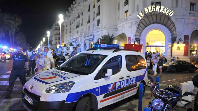 A police car is parked near the scene of an attack after a truck plowed through a crowd of revelers who had gathered to watch the fireworks in the French resort city of Nice, southern France, on July 15, 2016.
