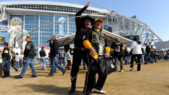 2/6/11 3:49:14 PM -- Arlington, TX -- SUPER BOWL XLV Pittsburgh Steelers vs Green Bay Packers  at Cowboys Stadium. -- Cowboy Kevin Fitzpatrick of Bandera, TX works his lasso around himself and Theresa Gladney, 53,  of Pittsburgh, PA. -- Photo by Eileen Blass, USA TODAY Staff