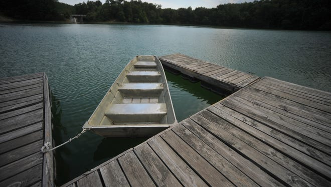 A row boat tied to a dock at Brookville Lake at Whitewater Memorial State Park Thursday, July 12, 2012.