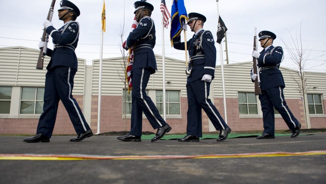 A color guard marches during a 2012 ribbon-cutting ceremony for Home for the Brave, a service for homeless veterans. State lawmakers hope that a new law giving veterans priority for affordable housing could help homeless vets.