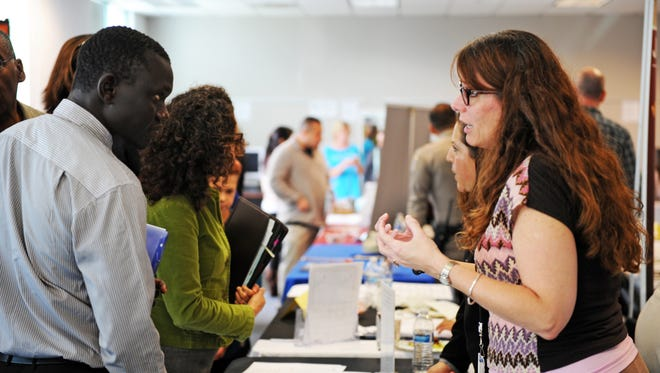 Kathy Parra from the Salinas City Elementary School District talks to a possible employee at Thursday's 1st Annual Salinas Community Job Fair.