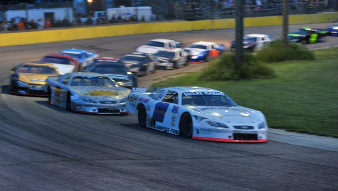 Mark Mackesy leads the field in a Super Late Model feature race during the 2014 season at State Park Speedway