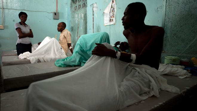 This photo taken on Dec. 10, 2014 shows cholera patients being treated at the Cholera Treatment Center in the Carrefour area of Port-au-Prince,Haiti. Victims' advocates hailed as vindication August 18, 2016, the United Nations' acknowledgment it played a role in a devastating cholera epidemic believed to have been imported by UN peacekeepers. The epidemic has killed 10,000 people since it broke out in 2010 in the vicinity of a base housing U.N. peacekeepers, in a country that previously was considered cholera-free.