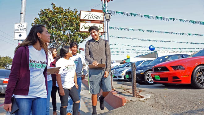 On an informational drive about Ciclov'îa Salinas on October 9th, youth volunteers fan out in east Salinas to meet business owners.