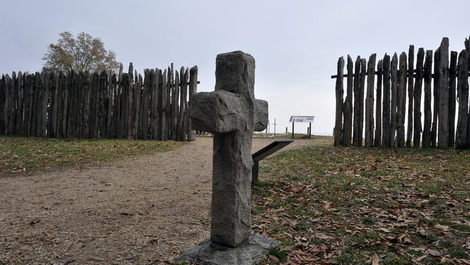 A stone cross marking the grave of a 17th century British settler is seen at the archaeological site of Jamestown, Virginia.