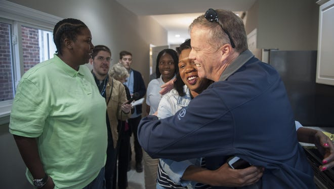 Homeless Army veteran Janne Dawson is overcome with emotion as she checks out her new home on Thurman St. in Camden. Three agencies that help vets in South Jersey received federal grants.