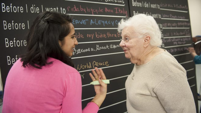 Program coordinator Janan Dave talks with Eileen MacKin, 82, of Gloucester Township. The event featured an interactive mural that will act as a community bucket list and conversation starter. Last year's event kicked off Gloucester Township's Conversation of a Lifetime campaign.