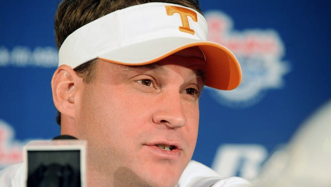 Tennessee coach Lane Kiffin participates in a Chick-fil-A Bowl press conference on Monday, Dec. 28, 2009, in Atlanta.