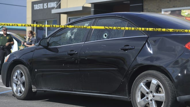 One person was shot Monday afternoon during an exchange of gunfire outside a local fast food restaurant.