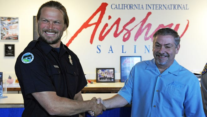 """At an announcement on Wednesday, Mid-Coast Fire Brigade volunteer firefighter Brian Gorrell was honored for his work as a """"Hometown Hero,"""" winning a chance to fly with the Air Force Thunderbirds during the upcoming 2016 California International Airshow Salinas. At right is Bruce Adams, executive director of the airshow."""