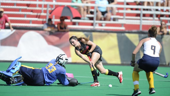 Rumson-Fair Haven grad Madison Magfuire (center) is seeing time for national field hockey power Maryland as a freshman.