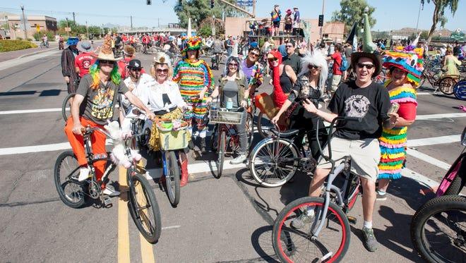 Costumed bike riders gather for the Tour de Fat bike parade. The event returns Oct. 1 to Tempe Beach Park.