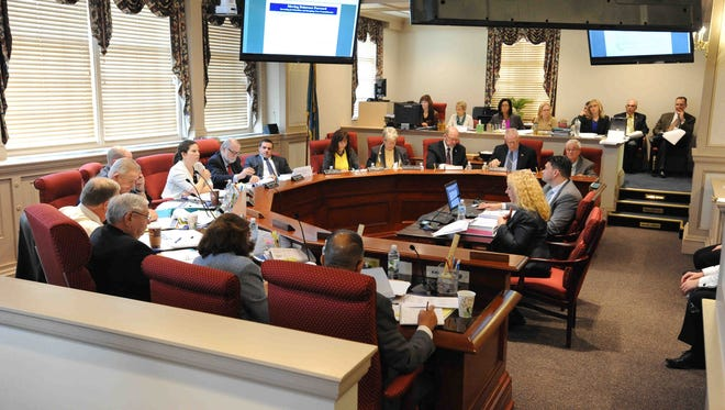 The General Assembly's budget-writing Joint Finance Committee works in Dover on Feb. 4, 2015.