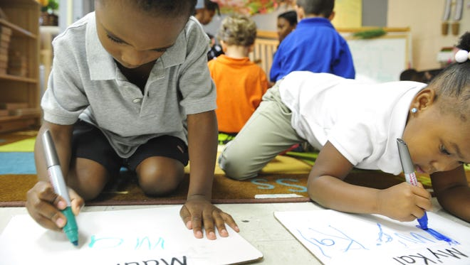 In this file photo, students Maurice Chatman, left, and My'Kal Page practice writing their names in Shandereen White's preK class at Ross Early Learning Center, Nashville.