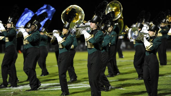 In this file photo, members of the Hillsboro marching band perform during their game at Overton High School Friday Sept. 13, 2013, in Nashville, Tenn.