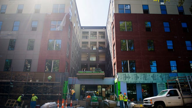 Construction continues on the new student apartment building, The Standard, on the corner of Cumberland Avenue and 17th Street on Wednesday Sept. 21, 2016. The apartments were scheduled to be completed on August 12, and the first students are now slated to move in on Oct. 9. (CAITIE MCMEKIN/NEWS SENTINEL)