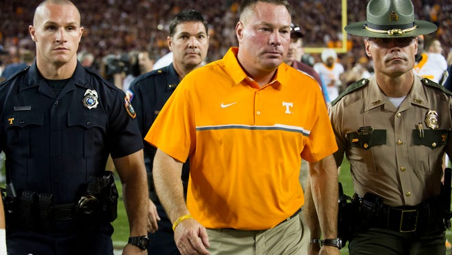 Tennessee head coach Butch Jones walk off the field after the loss to Texas A&M on Saturday, October 8, 2016. (SAUL YOUNG/NEWS SENTINEL)