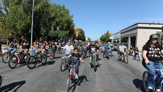 Cyclists filled the street for a Salinas Burrito Bike Ride that  ran during the 4th annual Ciclovia Salinas on Saturday.