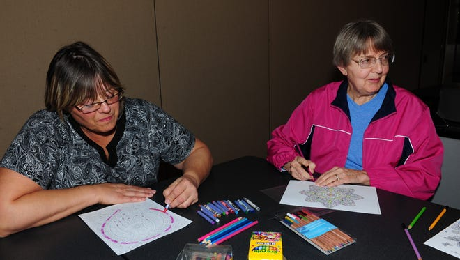 Friendships are made as Redford residents Gloria Rhodes and Judy Laswell gather for the Coloring for Adults event held at the Redford Township District Library on the second Monday of each month..