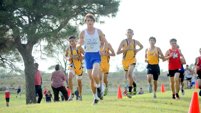 Carlsbad's Cory Calvani stays ahead of the pack Thursday at Hobbs.
