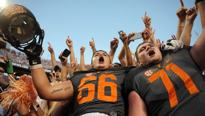 Tennessee offensive linemen Jack Jones, left, and Dylan Wiesman join the crowd at Neyland Stadium to celebrate beating Florida 38-28 on Sept. 24, 2016.