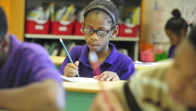 In this file photo, third-grader Kenya Jones works in Dr. Bianca Jones at Rocketship Nashville Northeast Elementary Nashville Tenn. May 19, 2015.