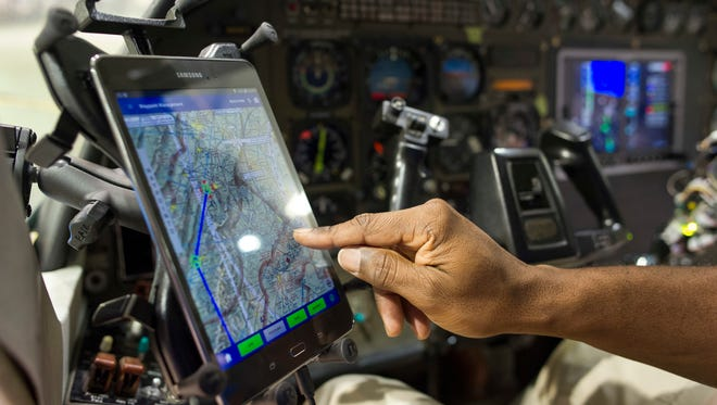 A pilot demonstrates how a tablet inflight controls the Aurora Flight Sciences' Aircrew Labor In-Cockpit Automantion System (ALIAS), which is mounted in a Cessena Caravan aircraft at Manassas Airport in Manassas, Va., Monday, Oct. 17, 2016. Government and industry are working together on a robot-like autopilot system that could eliminate the need for a second human pilot in the cockpit.