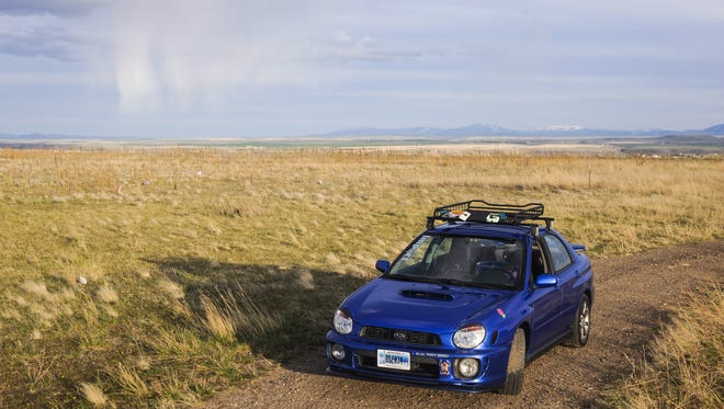 Subaru ambassador Kristen Steele drives her 2002 Subaru WRX on Gore Hill near Great Falls, Montana, on April 13.