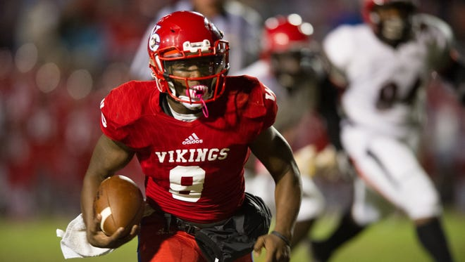 Warren Central quarterback Jessie Wilson and the Vikings ran past No. 1 Clinton, 50-32, to stun the top-ranked Arrows.