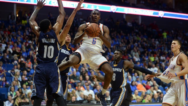 Oklahoma City Thunder guard Semaj Christon (6) looks to pass the ball in front of Memphis Grizzlies forward Troy Williams (10) during the third quarter at BOK Center in a preseason game on Oct. 13.